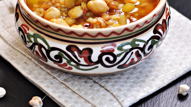 Moroccan harira soup in a traditional bowl/