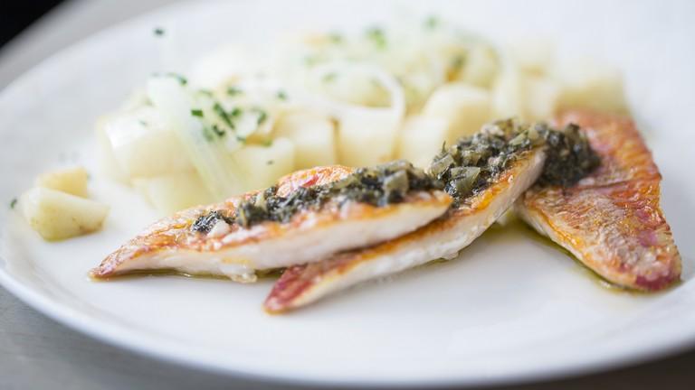 Fish dish at Café Miroir │ Courtesy of Café Miroir