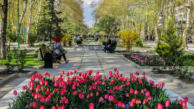 A maze of flower-lined pathways at Mellat Park