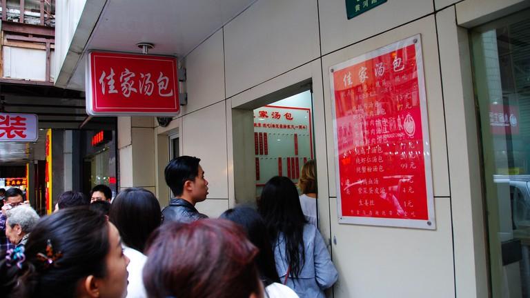 People Line up at Jia Jia Tang Bao