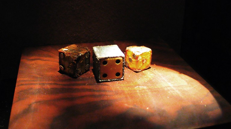 Decaying dice at the Museum of Jurassic Technology