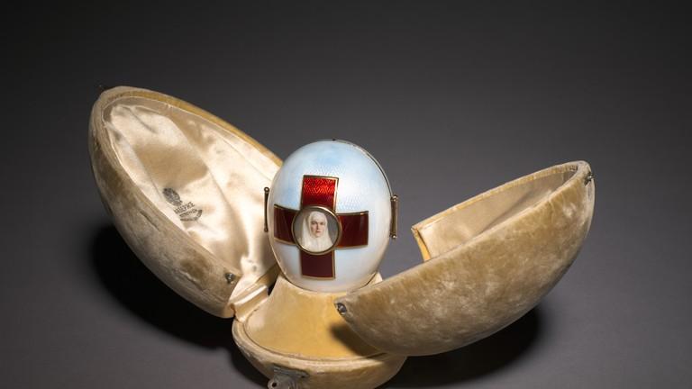 Imperial Red Cross Easter Egg, 1915. Firm of Peter Carl Fabergé (Russian, 1846-1920), Henrik Wigström (Russian, 1862-1923). Gold, silver, enamel, glass.