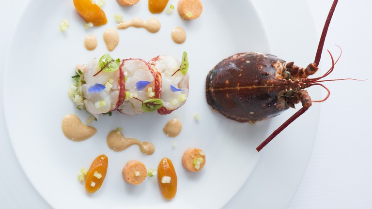 The 'surprise de homard' at Restaurant Guy Savoy features medallions of poached lobster with lobster jelly.