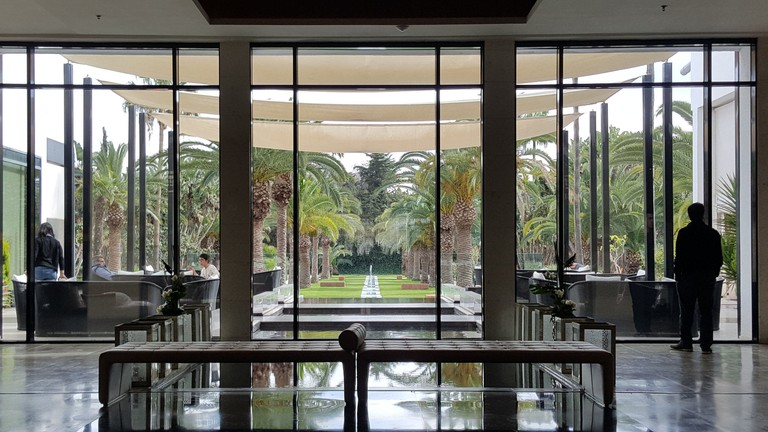 View of the manicured gardens from the stylish bar at Sofitel Rabat Jardins Des Roses