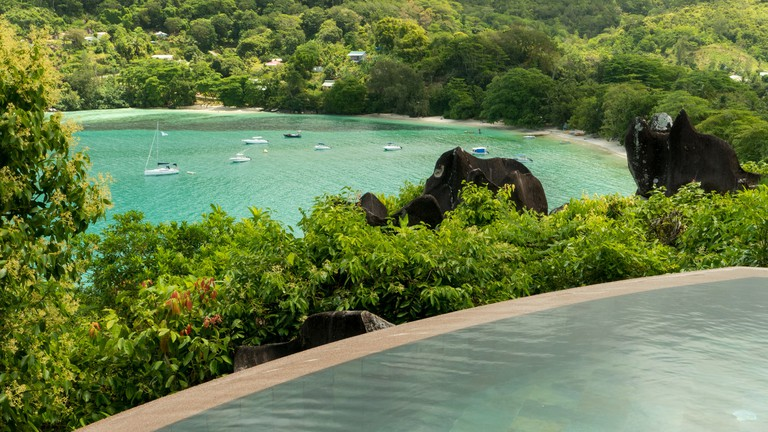 Relax in the pool over looking the stunning and secluded Port Launay marine park.