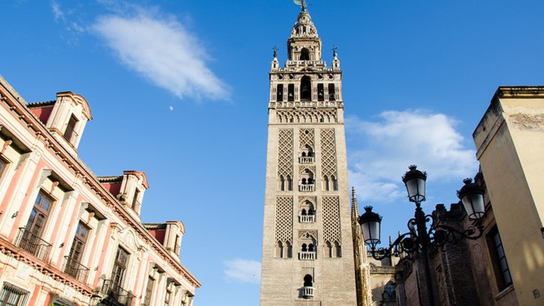 Seville cathedral's iconic belltower is a one-minute walks from Hotel Patio en Santa Cruz