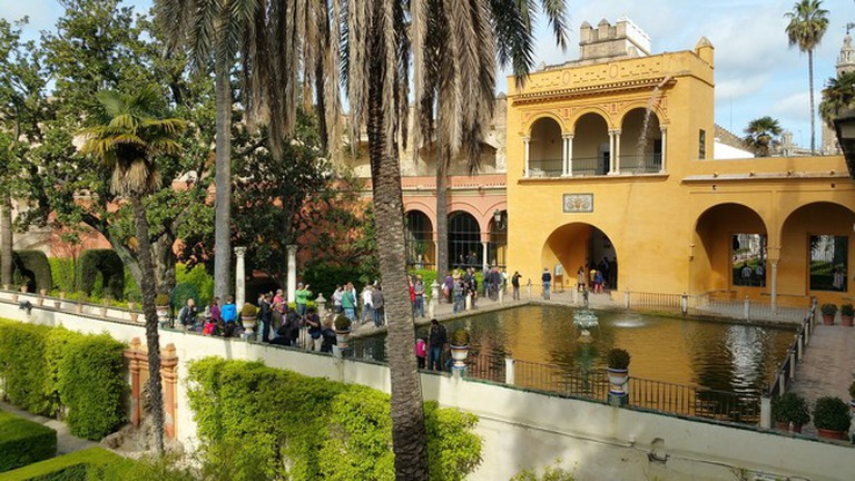Seville's spectatcular Alcazar palace is easily reachable on foot from the Casa de Colón; waldomiguez