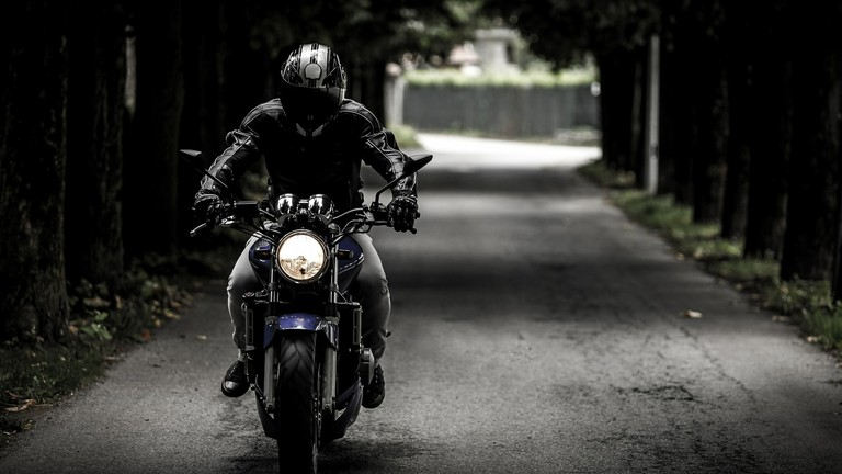 A biker riding a motorbike