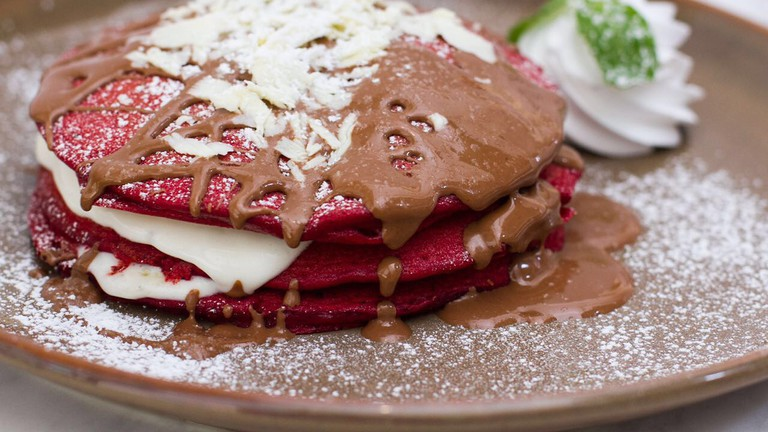 Red Velvet Pancake topped with warm chocolate syrup