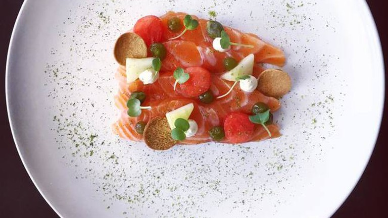 Salmon gravlax with dill and capers at Racines restaurant