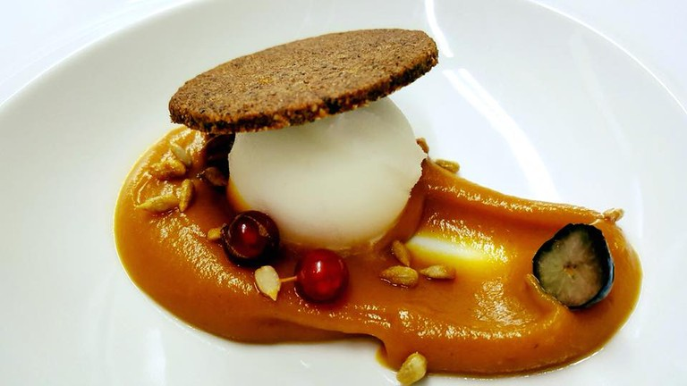 Cream of roasted pumpkin, lemon sorbet and carob biscuit at Restaurante Tio Pepe, Peniscola.