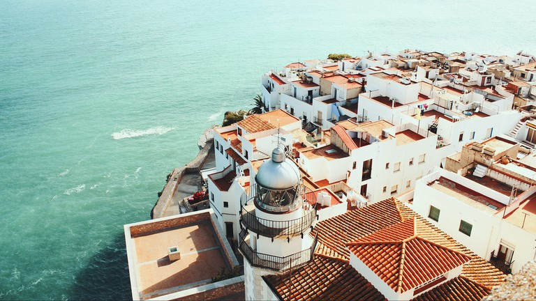 A view over Peniscola's Old Town rooftops and the sea.