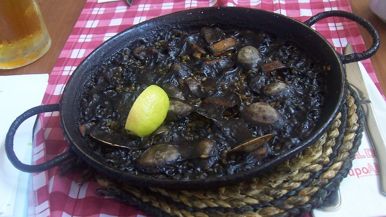 Black paella made with squid ink