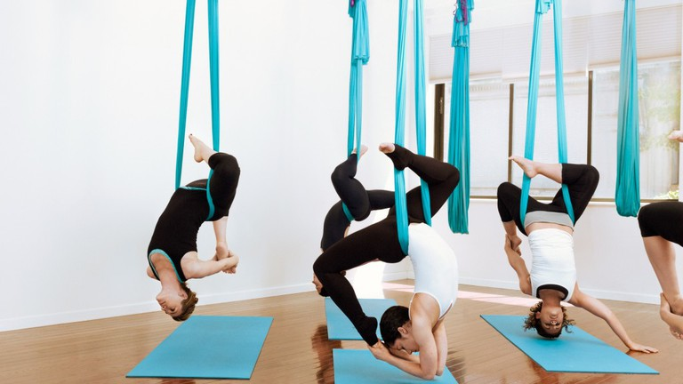 Aerial yoga suspended in hammocks