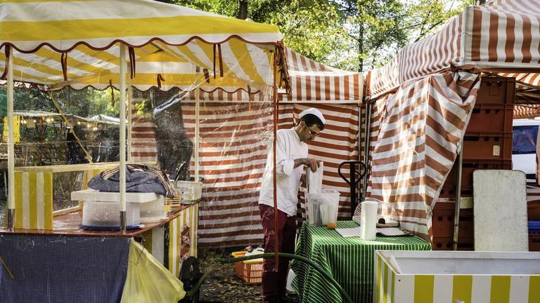 Vendor sets up at Boxhagener Platz Food Market