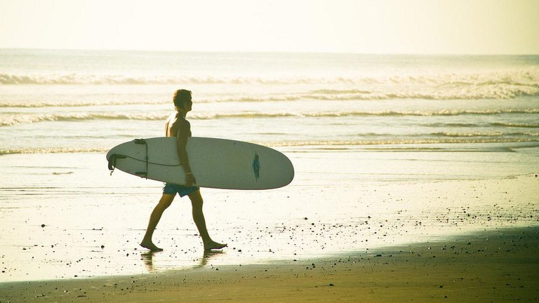 Learn to surf and speak Spanish