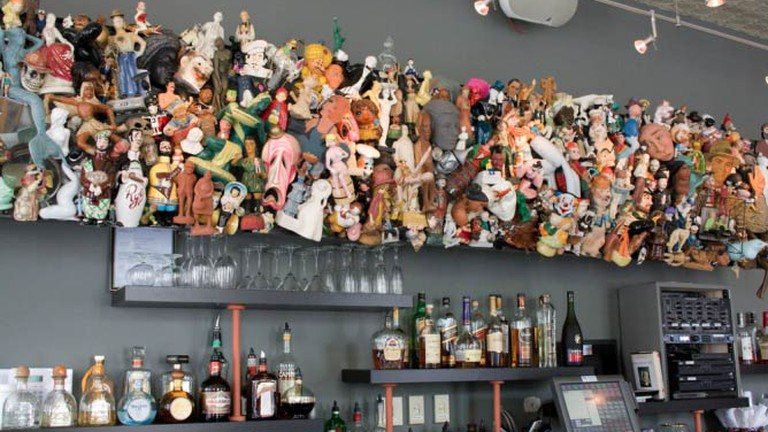 The sculpture behind the bar on the first floor of Taylor's People's Park