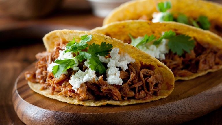 Pulled pork tacos with feta cheese and cilantro