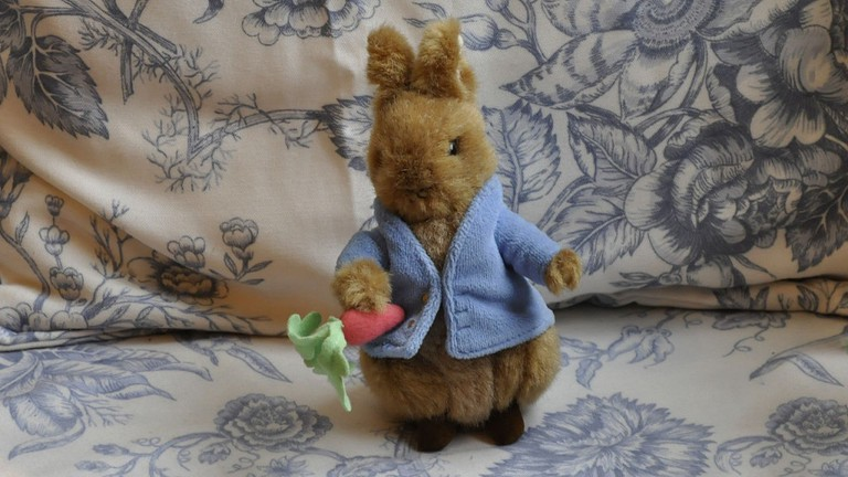 Peter Rabbit plushie awaits diners at the Garden Cafe