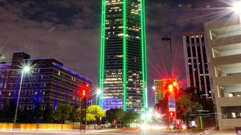 Bank of America Plaza building glows green at night