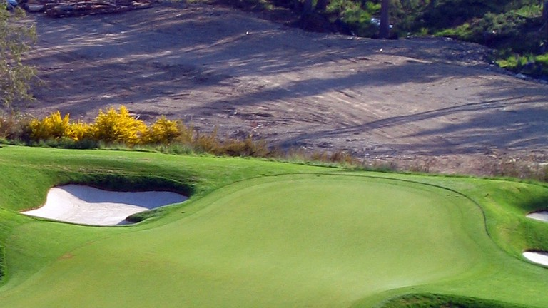 Well-groomed greens are crucial to a good golf course