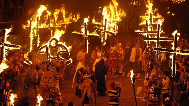 Burning crosses form part of a breathtaking parade of fire and fireworks on bonfire night in Lewes, England.