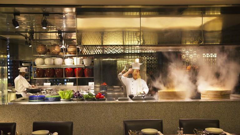Chefs preparing food at the Chine Kitchen