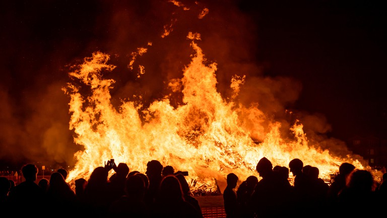People watching the bonfire in celebration of Guy Fawkes night.
