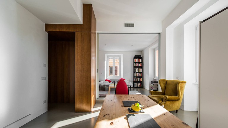The entrance and living space of this stylish Airbnb in Ostiense, Rome