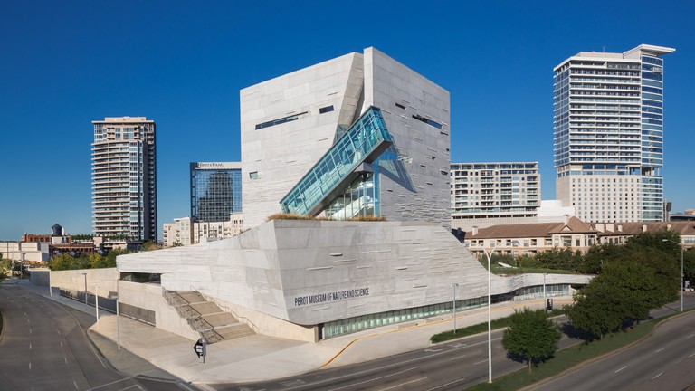 A glass-encased escalator is an interesting aspect of the Perot Museum's architecture