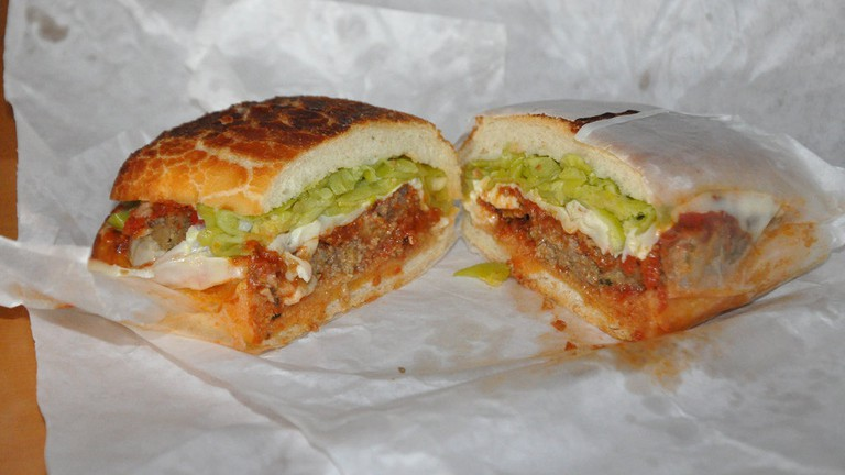 Delicious meatball sandwich with banana peppers, served in Dutch Crunch bread