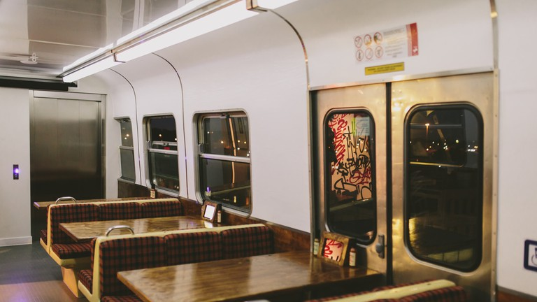 Inside one of Easey's train carriages