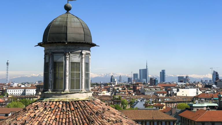 The Milan skyline and mountains beyond –the stunning view from Basilica San Vittore al Corpo in Sant Ambrogio | © Shutterstock/Paolo Bona