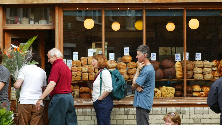 People queuing outside a bakers at Columbia Flower Market, London