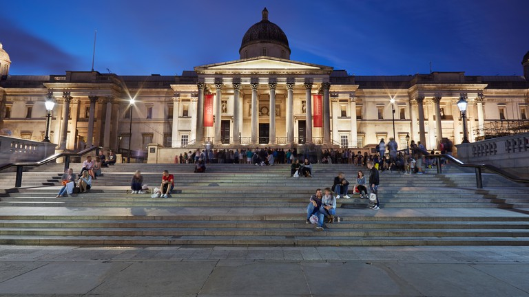 The National Gallery at Trafalgar Square in London in the evening.