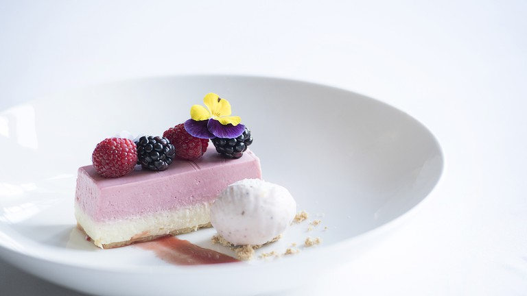 Beautifully crafted strawberry and vanilla cheesecake served at the Town House