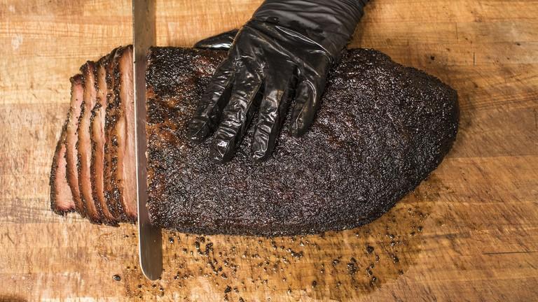 Slicing brisket at Franklin BBQ