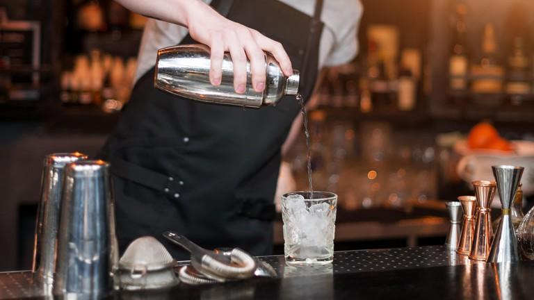 Bartender is making cocktail