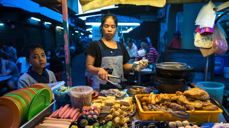 Street food stalls at a vibrant night market in Malaysia