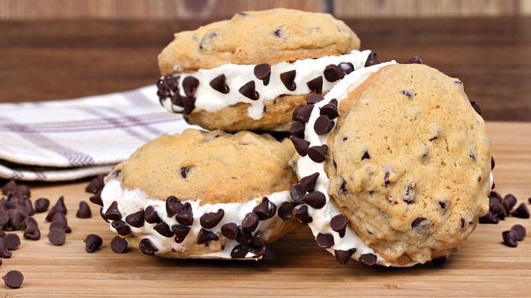 Homemade vanilla ice cream chocolate chip cookie sandwiches.