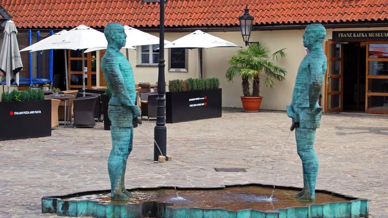 Peeing Statue (Figures by artist David Cerny) outside the Kafka Museum in Mala Strana, Prague.