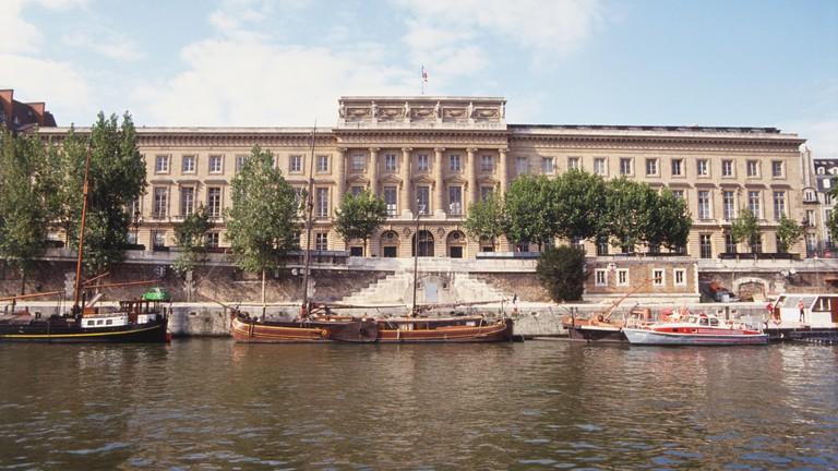 France, Paris, St.-Germain-des-Pres, Hotel des Monnaies, the Mint, large ornate museum, trees and river in front.