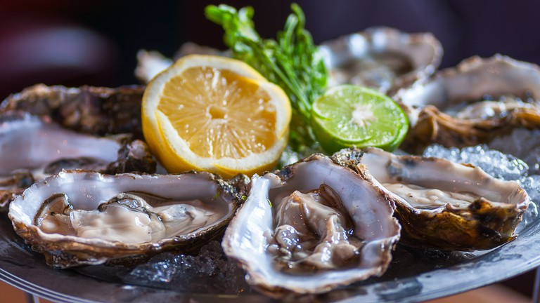 Fresh oyster with lemon and lime.