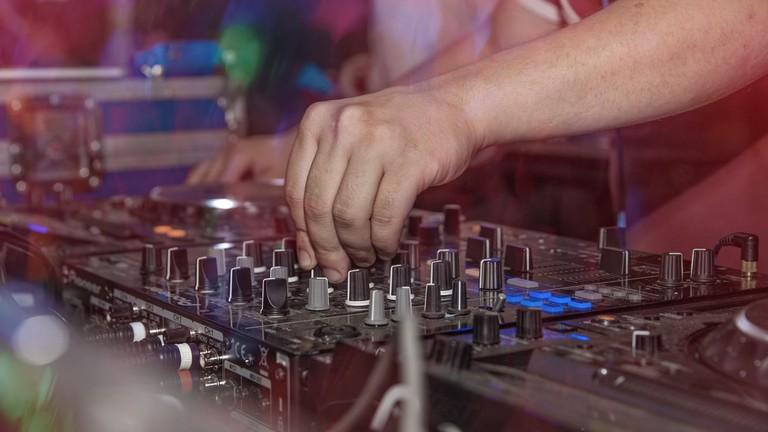 DJ working the decks