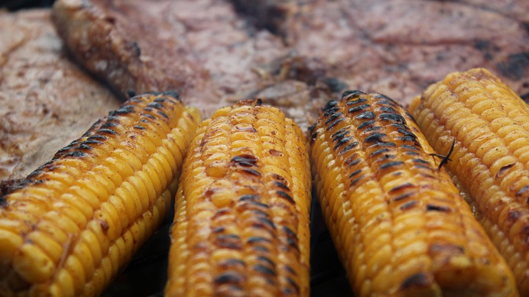 Grilled corn on the cob is a popular side dish at braais