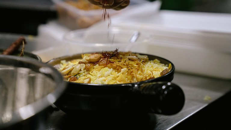 The finishing touches on biryani rice at Rangoon Tea House, Yangon