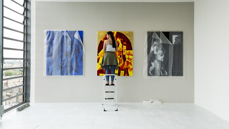 A student puts the finishing touches to her degree show at Goldsmiths