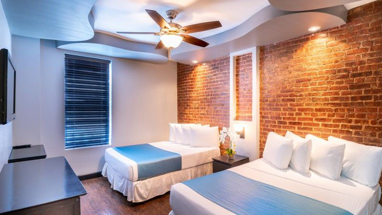 Broadway Hotel and Hostel's rooms are bright and airy