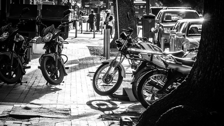 Motorbikes line the pavements of Avenida Chapultepec