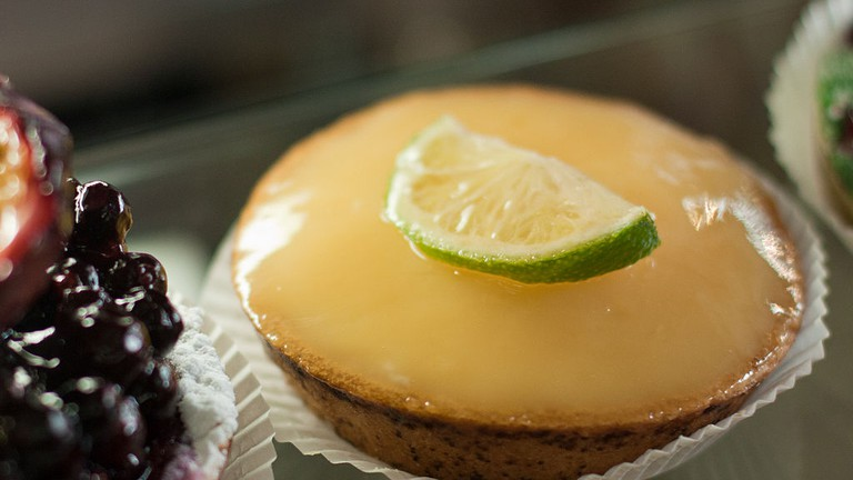 Custard tart topped with a slice of lime at Aurore Capucine